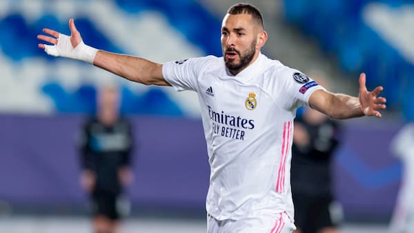 Benzema lifts Real Madrid to UCL knockout stage